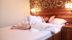 Blonde lying in white bed Stock Footage