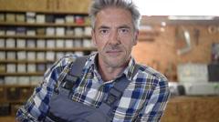 Portrait of carpenter standing in workshop Stock Footage