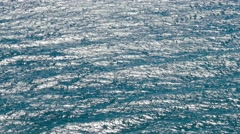 AERIAL: Surface of stormy sea in sunlight Stock Footage