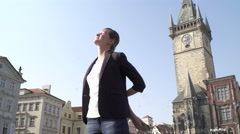 Cute Young Woman  Looks around At The  Prague, Old Tow Square. Stock Footage