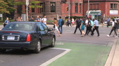 Cars bikes transit and pedestrians in the streets Stock Footage