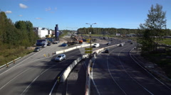 Lot of cars go round the construction site of the temporary multi-lane road. Stock Footage