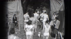 1948: men are seen returning after their act and a lady runs holding her dress Stock Footage