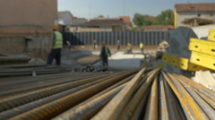 Workers installing reinforcement at building construction,bar closeup by Sheyno. Stock Footage
