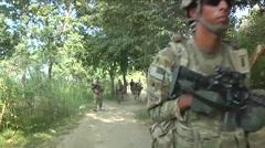 Marines on foot patrol in the Nangarhar Province of Afghanistan. Stock Footage