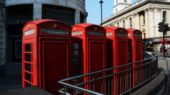 London Phone Booths in Charing Cross being covered by shadows Stock Footage