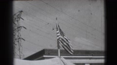 1948: black and white video of the american flag waving in the sky CHICAGO Stock Footage