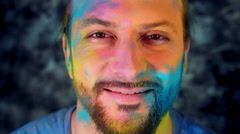 4k Colourful LGBT Shot of a Man in Holy Powder Smiling Happy Stock Footage