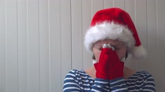 Disappointed woman with Christmas Santa Claus hat suffering from depression Stock Footage