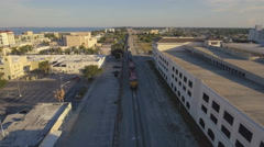 Aerial View of Train in Small Town Stock Footage