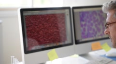 Microbiologist in office working on sample Stock Footage