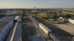 4K Aerial View of Train Going through Intercoastal Town Stock Footage