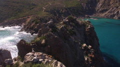 AERIAL SHOT OF A ROCK NEAR THE SEA Stock Footage