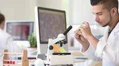 Student in biology using microscope in training class Stock Footage