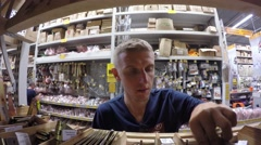 Man Shopping in Hardware Store with Materials for Construction Stock Footage