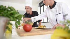 Young cook student in training course Stock Footage