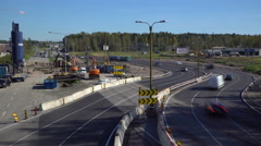 Many cars go round construction site of temporary multi-lane road. Time lapse. Stock Footage