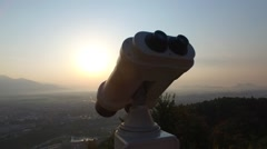 Lookout binoculars in the mountains and sunset Stock Footage