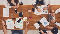 Group of busy business people working in office, top view Stock Photos