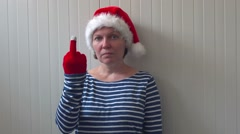 Woman with Christmas Santa Claus hat giving middle finger Stock Footage