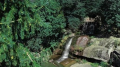 Big paradise waterfall in green forest Stock Footage