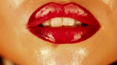 Woman licking her lips Stock Footage