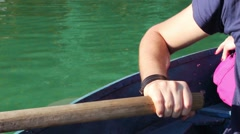 Man pulling a blue boat with oar, faceless Stock Footage