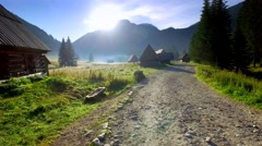 Footpath between cottages in the valley Chocholowska at sunrise, Tatra Mountains Stock Footage