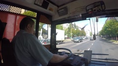 Bus Driver Sitting at Steering Wheel and Driving on City Road Stock Footage