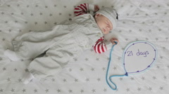 A three-week old boy asleep Stock Footage