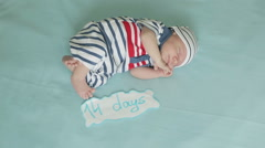 A sleepy two-weeks old boy moving Stock Footage