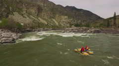 AERIAL VIEW of extreme rafting on the mountain river Stock Footage