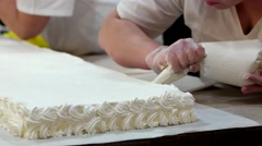 Confectioner prepares celebration cake with white cream Stock Footage