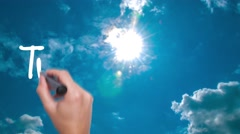 Transparency - concept with hand writing on the sky. Man writing. Blue sky wi Stock Footage