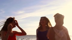 Group of happy women or girls dancing on beach 46 Stock Footage