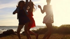 Group of happy women or girls dancing on beach 51 Stock Footage