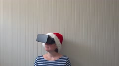 Woman with Christmas Santa Claus hat and VR headset Stock Footage
