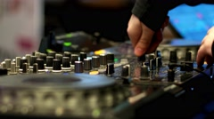 DJ at work in a nightclub musician hand operated DJ-controller, remote audio Stock Footage