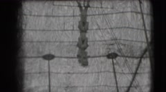 1948: a couple of individuals who hang from each other in a long row, looking Stock Footage