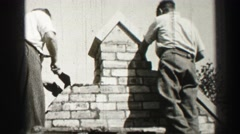 1952: bricklayers working quickly as a team to construct EDINBOURGH, SCOTLAND Stock Footage