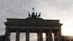 Real Time locked down medium shot of the Brandenburg Gate in Berlin at sunset. Stock Footage