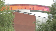 People walking in colored rainbow on top of the museum of art (Aros) in Aarhu Stock Footage