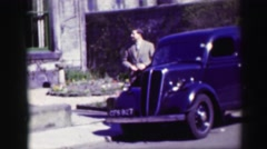 1952: a man wandering on street waiting someone EDINBOURGH, SCOTLAND Stock Footage