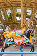Pretty carousel adventure amusement park Stock Photos