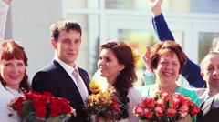 Portrait of newlywed couple having fun with guests bridesmaids and groomsmen. Stock Footage