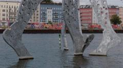Tilt up shot of The Molecule Men sculpture in Berlin, Germany. Stock Footage