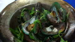 Thai, Chinese seafood baked mussels in the pot with herb Stock Footage