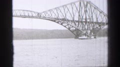 1952: a boat is seen passing by a bridge EDINBOURGH, SCOTLAND Stock Footage