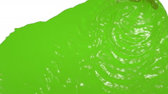 Green liquid flow falls from above fills screen. juice Stock Footage
