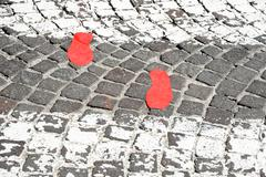 Red footsteps in town Stock Photos